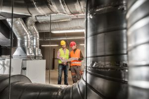 Environmental Engineers Checking Airflow Systems